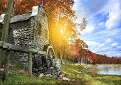 stock photo of water-mill  - Old water mill on the lake in autumn - JPG