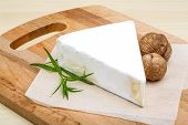 picture of brie cheese  - Brie cheese with wallnut and terragon on wood background - JPG
