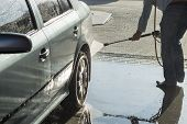image of pressure-wash  - The process of washing the car at the car wash - JPG