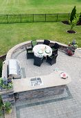 picture of paving  - View looking down at a brick paved outdoor living area on an open - JPG