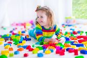 picture of preschool  - Preschooler child playing with colorful toy blocks - JPG