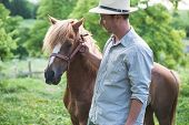picture of panama hat  - Horse and man in panama hat - JPG