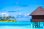 picture of jetties  - Water bungalows and wooden jetty with turquiose water on Maldives - JPG