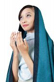 picture of fitri  - Young Asian woman in veil looking up and praying with open hands gesture isolated on white background - JPG