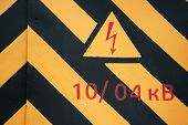stock photo of substation  - warning symbol on old doors of the transformer substation - JPG