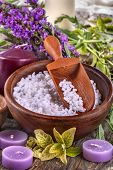 pic of salt-bowl  - salt bath in wooden bowl with flowers and leaves in background - JPG