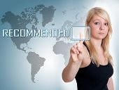 stock photo of recommendation  - Young woman press digital Recommended button on interface in front of her - JPG