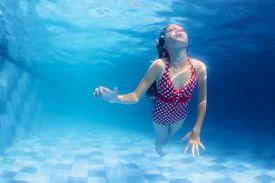 stock photo of child development  - Child swimming underwater lesson  - JPG