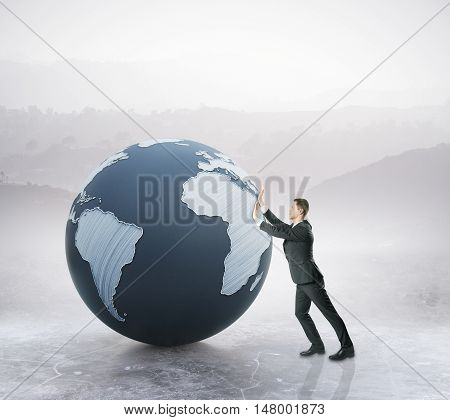 Businessman pushing abstract terrestrial globe on landscape background. Global business concept. 3D Rendering