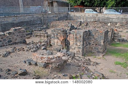 CATANIA ITALY - OCTOBER 10 2012: The archaeological site at the entrance to the Benedictine monastery in Dante Square on October 10 in Catania.