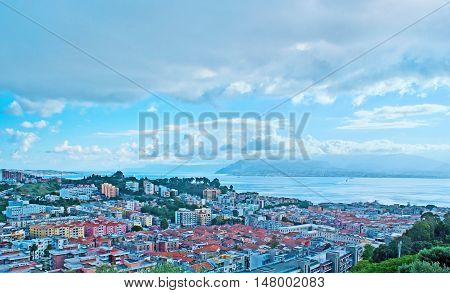 The aerial view of Messina housing Strait and foggy shore of Italian mainland occupied by Reggio Calabria Italy.