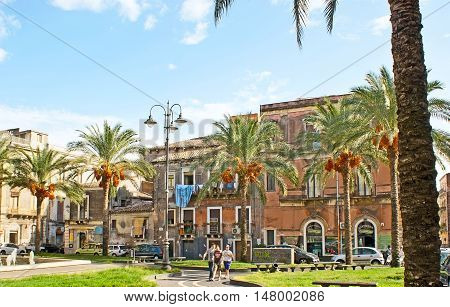CATANIA ITALY - OCTOBER 10 2012: The Cutelli Square decorated with the tiny garden surrounded by palms on October 10 in Catania.