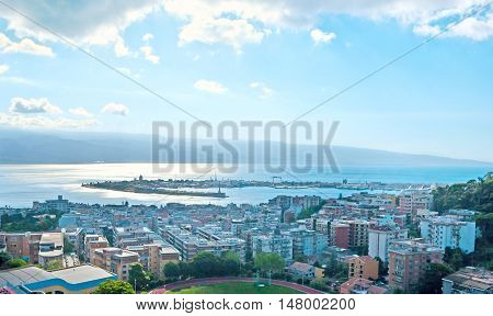 MESSINA ITALY - OCTOBER 2 2012: The aerial view of the city its port Messina Strait and Reggio Calabria of Italian mainland on other shore on October 2 in Messina.
