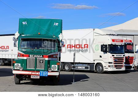 NAANTALI, FINLAND - SEPTEMBER 16; 2016: Scania LS 140 the first cargo truck of Ahola Transport in front some of the company's new fleet presented on the Open Door Event in Naantali Finland.
