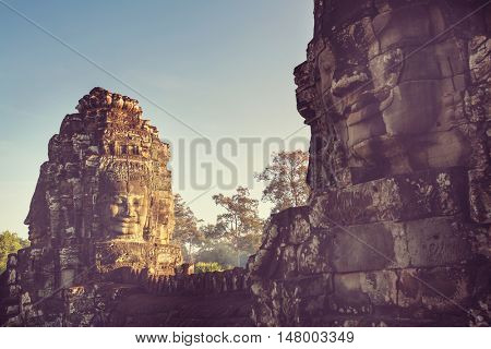 Stone faces of ancient Khmer culture temple of Bayon in Angkor area near Siem Reap, Cambodia