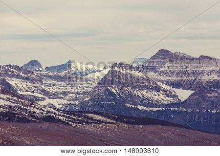 Scenic snow-covered peaks in winter in the Glacier National Park, Montana. USA. Instagram filter.