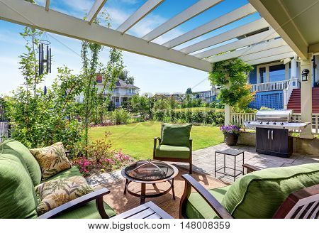 Covered Patio Area With Outside Chairs In The Backyard Garden. House Exterior.