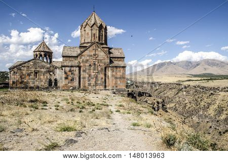 Side elevation on the monastery Ohanavank over the precipice at canyon river Kasakh