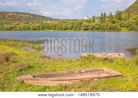 idyllic river scenery with old wooden boats
