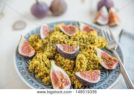 Healthy quinoa salad with herbs and fresh figs