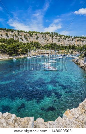 White sailing yacht waiting for their owners.  National Park Calanques on the Mediterranean coast.  The picturesque narrow fjords between the rocky shore