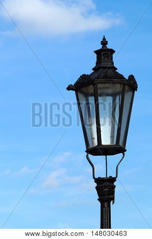 Outdoor view of an old rusty street lamp or light