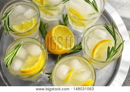 Cold fresh cocktails with lemon on metal tray