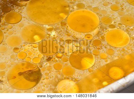 Fat drops on a liquid surface. cholesterol