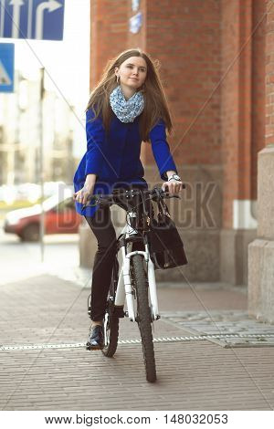 Businesswoman On Bike