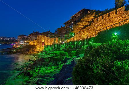 Night photo of ruins of reconstructed gate part of Sozopol ancient fortifications, Bulgaria