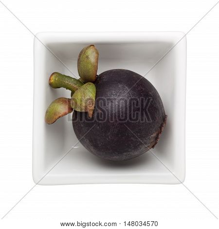 Mangosteen in a square bowl isolated on white background