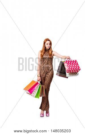 Woman with many shopping bags isolated on white