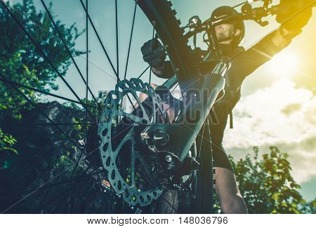 Extreme Biking Concept. Bike Front Wheel Brakes Closeup Perspective.
