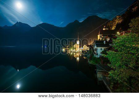 Hallstatt Austria Night Time Photo. Hallstatt Cityscape and the Moon Lake Reflections.