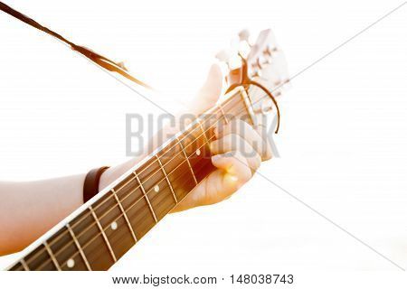 The young guy playing guitar in high-key(soft focus)