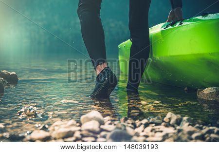 Kayak Lunching Closeup. Sportsman Lunching His Kayak. Kayaking Theme.