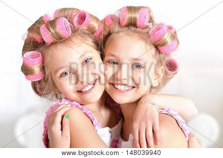 Cute little tweenie   girls   in hair curlers