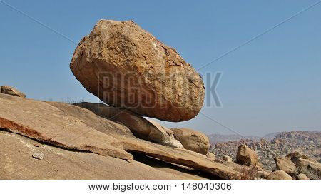 Big balancing granite boulder in Hampi India. Popular area for bouldering.