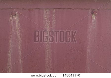 Painted old metal dark pink background texture with nuts and streaks