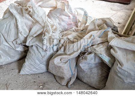 Heap of dirty cellophane sackful during overhaul