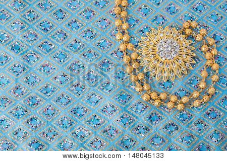 Shiny Gold Jewelry On Elegance Fabric