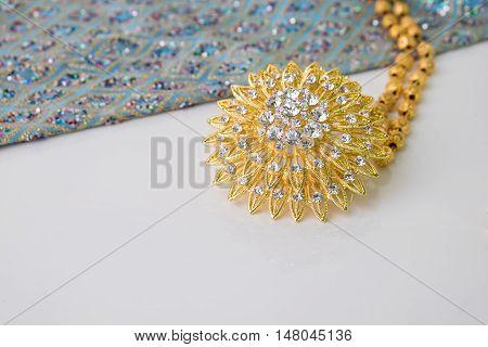 Shiny Gold Jewelry On White Background