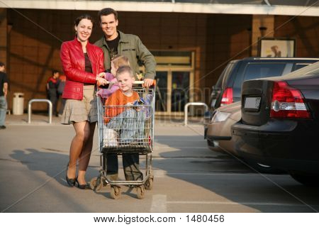 Family On A Shop Parking