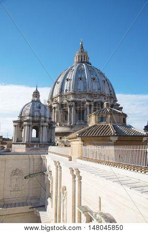 Romantic view on dome of the Saint Peter's Basilica ( Famous Roman landmark ) Vatican. Rome. Italy. Europe