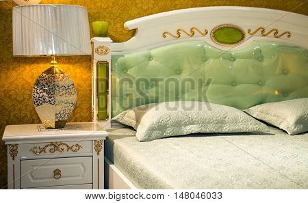Ornate bedframe and bedroom furniture with an upholstered headboard