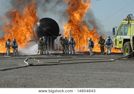 Firefighters train for battling an aircraft fire