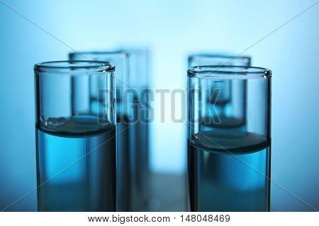 Tubes with water, closeup. Saving water concept