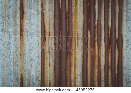 texture old galvanized iron become rusty on the wall.