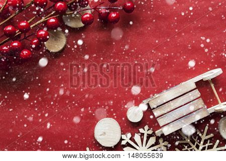 Christmas Decoration Like Snowflakes And Sleigh. Card For Seasons Greetings With Red Paper Background. Copy Space For Advertisement. Flat Lay View