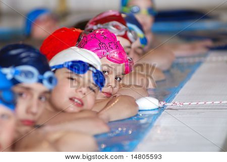 childrens in row at swimming pool